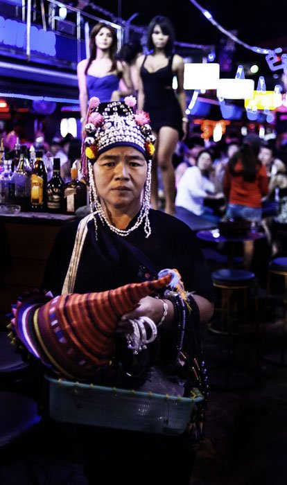 Akha woman selling trinkets to tourists in Phuket.