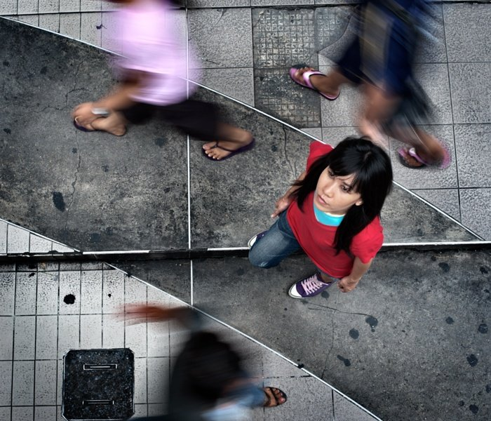 Looking down at a woman on the sidewalk in Bangkok. Tips For Travel Photography etiquette in Thailand