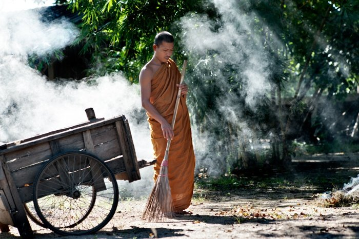 Tips For Travel Photography etiquette in Thailand. Buddhist Monk Sweeping