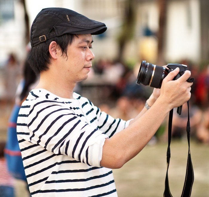Tips For Travel Photography etiquette in Thailand Photographer at an Outdoor Event