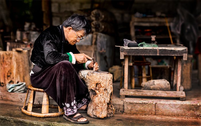 Hmong Blacksmith Stitched taken during a Chiang Mai Photo Workshop