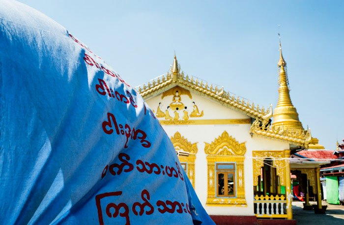 Temple and flag on Inle lake © Kevin Landwer-Johan