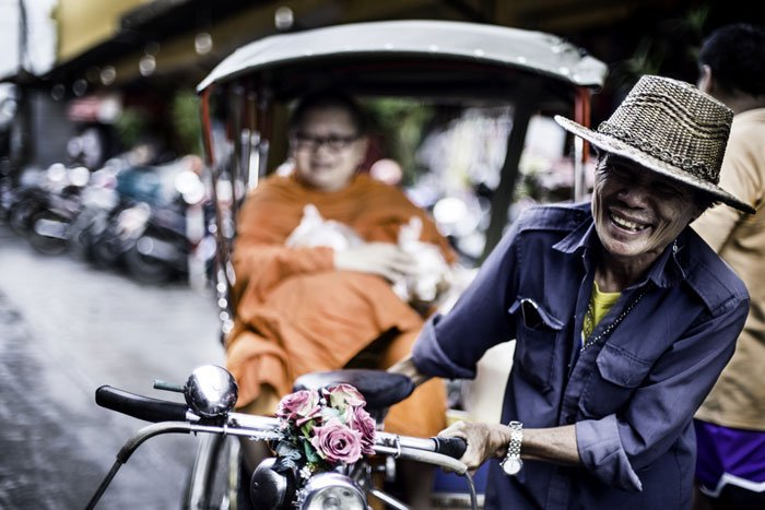Buddhist monk in a tricycle taxi
