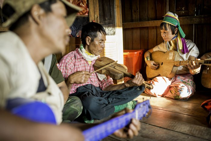 Kayan ethnic minority people in Myanmar playing guitar and violin