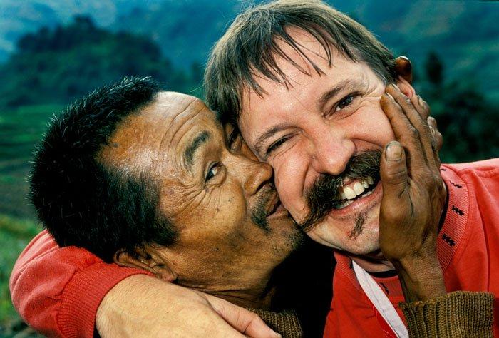 Kevin Landwer-Johan being kissed on the cheek by a Lisu man.
