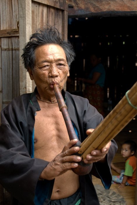 Lahu Musician in Mae Hong Son Province, Thailand. Tips For Travel Photography etiquette in Thailand