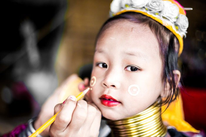 Kayan girl having her makeup applied in Chiang Mai, Thailand, how relationship affects your photography