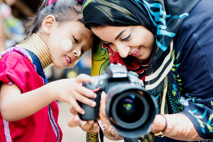 Kayan girl and Arab woman with a DSLR camera during a Chiang Mai Photo Workshop