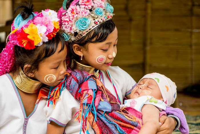 Kayan girls holding a young baby