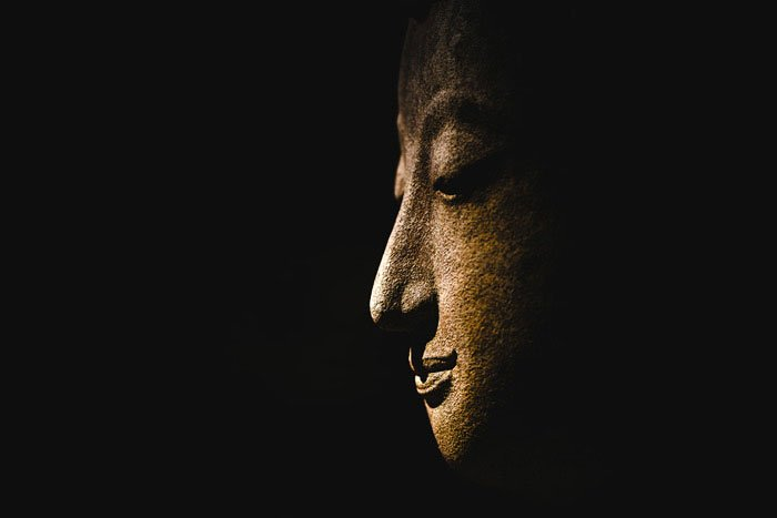 Buddha Statue Face with a dark background