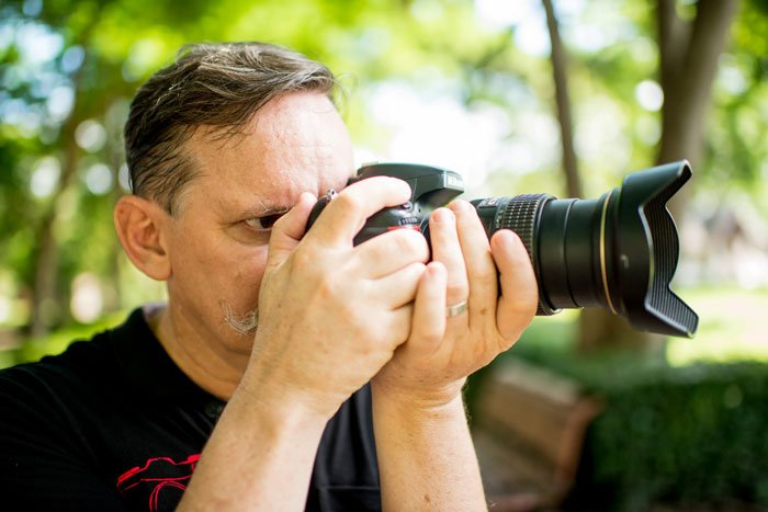 Man using a DSLR camera