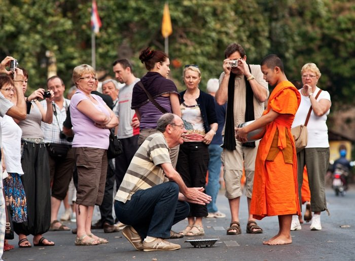 Tips For Travel Photography etiquette in Thailand Buddhist Monks Receive Offerings