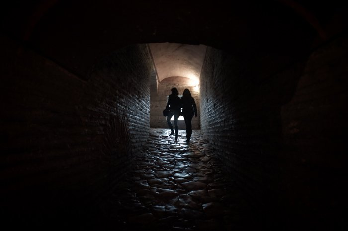 Why I Believe Using Manual Mode Is The Best Option Silhouettes in a Passageway