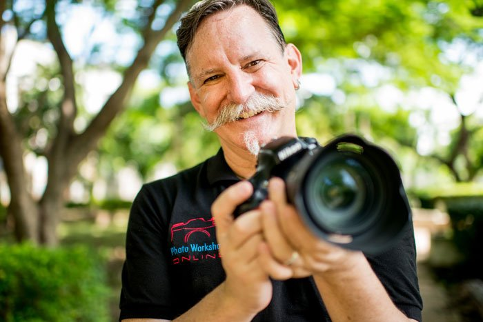 Kevin Landwer-Johan with DSLR Camera - Why I Believe Using Manual Mode Is The Best Option