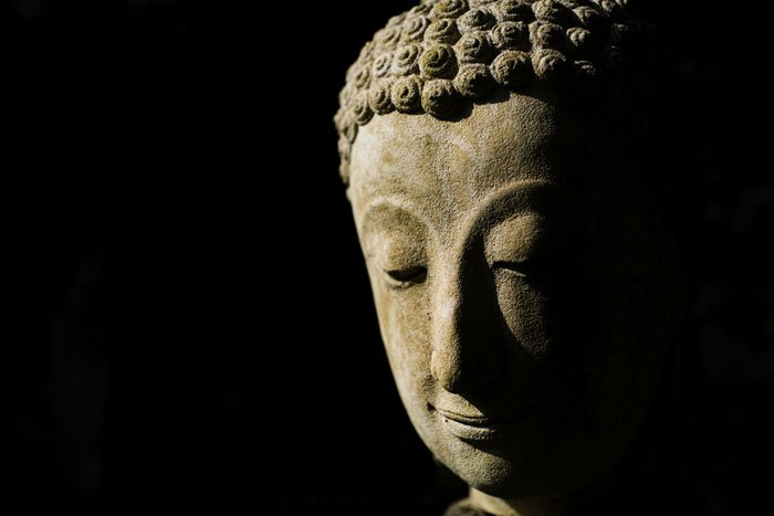 Buddha statue head high contrast about the best exposure choice