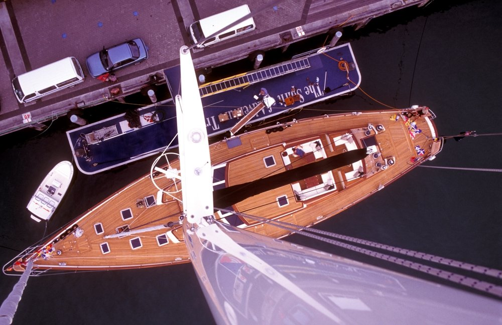 Looking down a yacht mast from the top.
