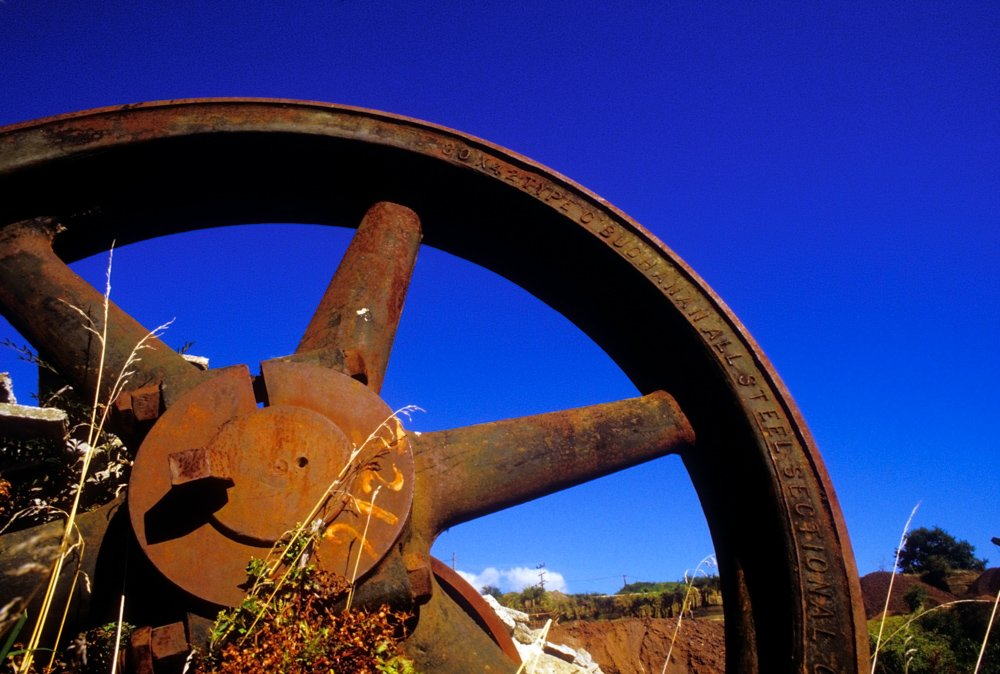 Large rusty iron wheel.