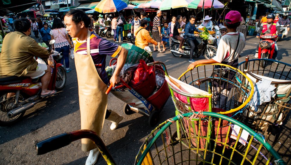 Market Action during a Chaing Mai Photo Workshop at Muang Mai Market, Thailand.