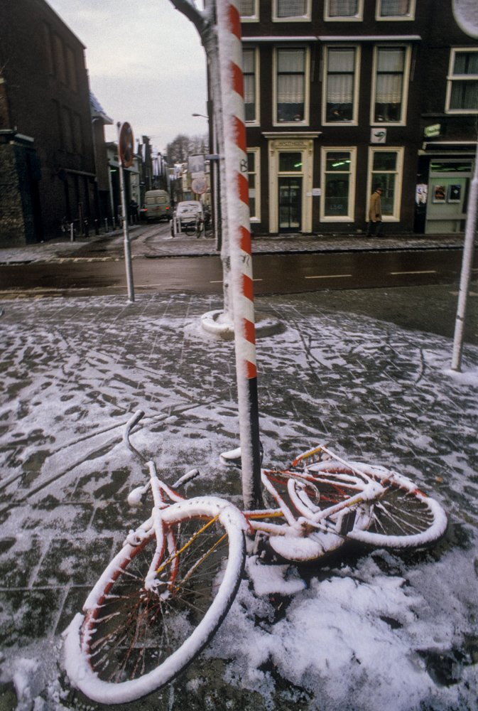 Bicycle on ground covered with snow